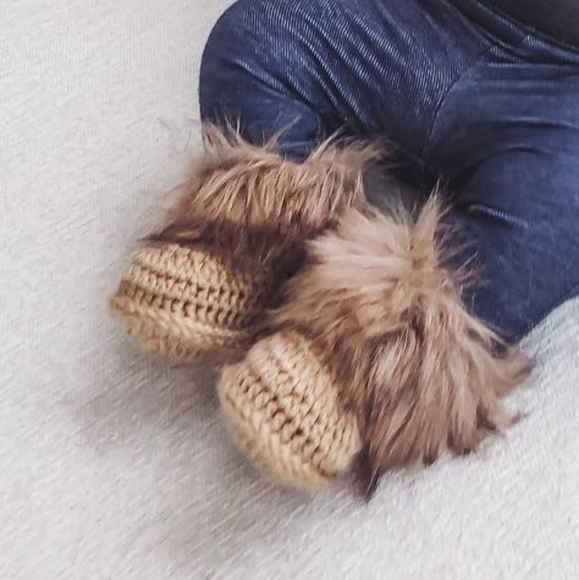 Faux fur crocheted baby booties in beige colour
